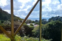 Harbour and hill views from the available bedroom.