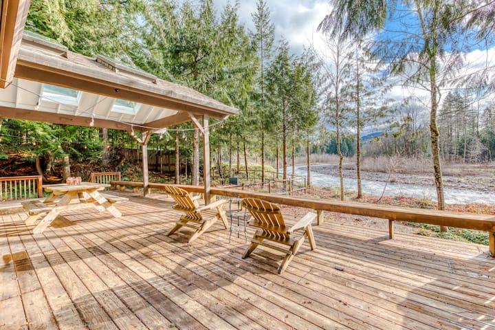 Dog-friendly, riverfront home w/ a private hot tub, shared pool, & sauna