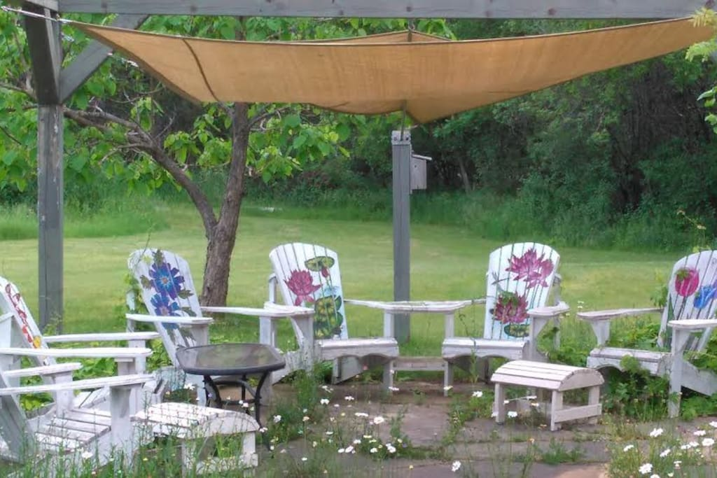 Grab a book or a drink and relax under the shade sails.