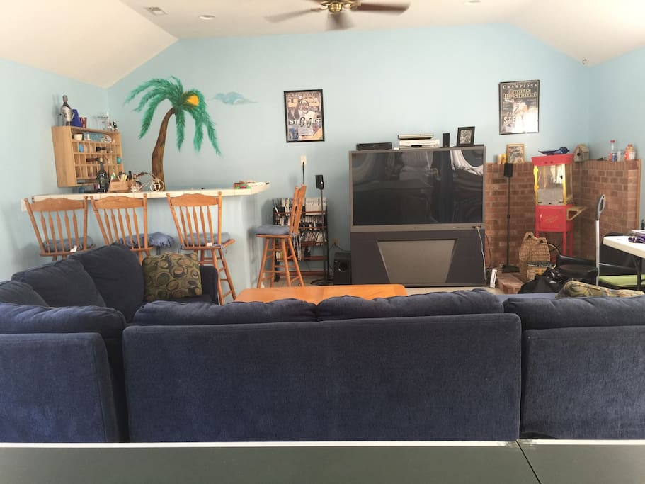 Available for extra fee- Large detached game room with pull out sofa, pool table, ping pong table, air hockey, electric dart board, wet bar, and video games!