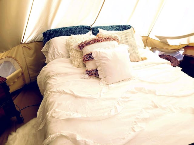 The canvas tent is quite spacious and fits a comfortable queen size bed perfectly.   The first aid kit and hair dryer are in the night stand dressers.