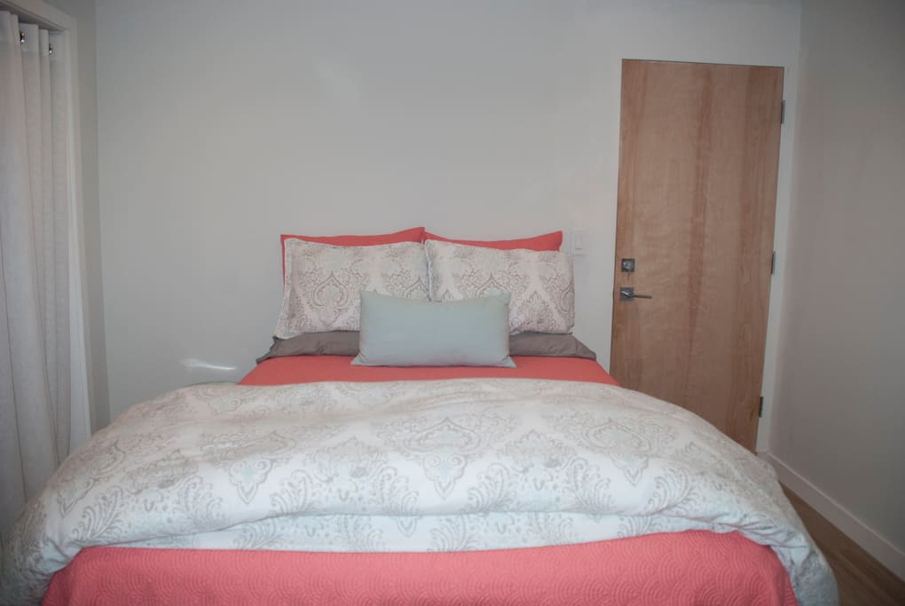 Private bedroom with comfortable queen bed