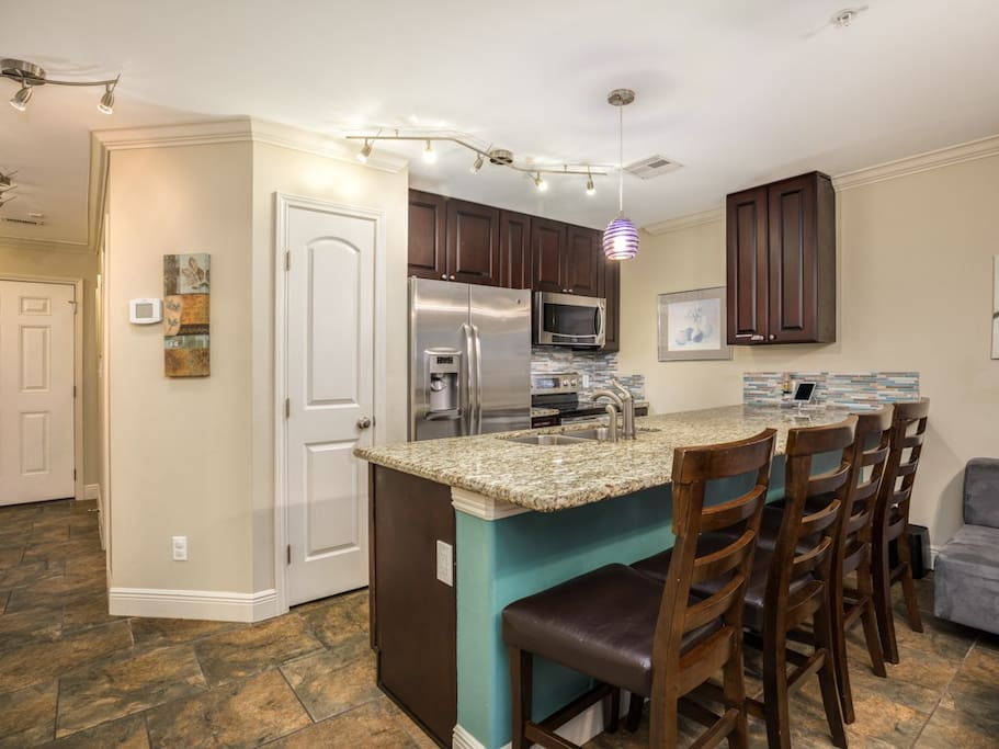 A granite counter doubles as a dining space.