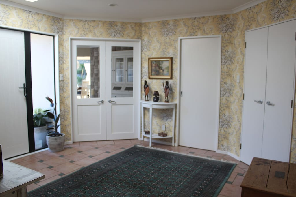 Driveway leads to front door and spacious hallway for wheelchair  access