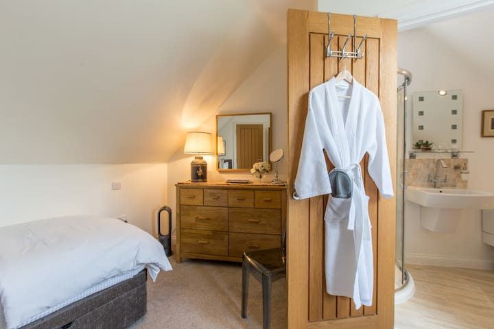Second bedroom access into ensuite shower.  Robes, slippers & toiletries provided.