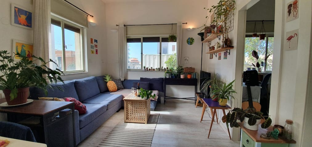 Bright planted filled apartment in Neve Zedek