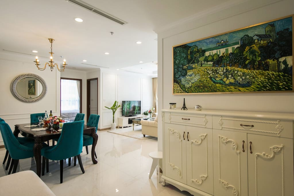 """Main entrance: Greeted by Van Gogh's """"Daubigny's castle"""" painting above a cream laced sideboard"""