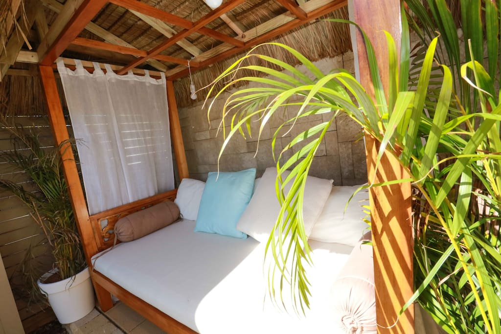 Relax on your covered day bed in your private courtyard with views of the lake at your front door step.