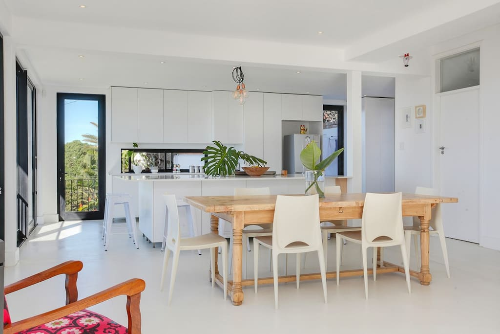Dining area and brand new open-plan kitchen with large island for easy entertaining