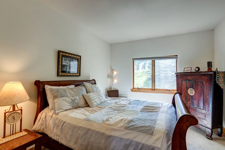 Main floor bedroom with an attached bathroom. 21 inch TV and closet with extra linens and board games!