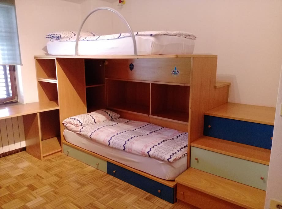 Bedroom with a bunk bed and a big working tabele.