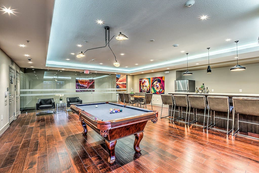Pool table/lounge area right before you walk outside to the pool. In this room, there is coffee made every morning and it has 2 vending machines with snacks/medicine/beverages! (Open 24hrs)