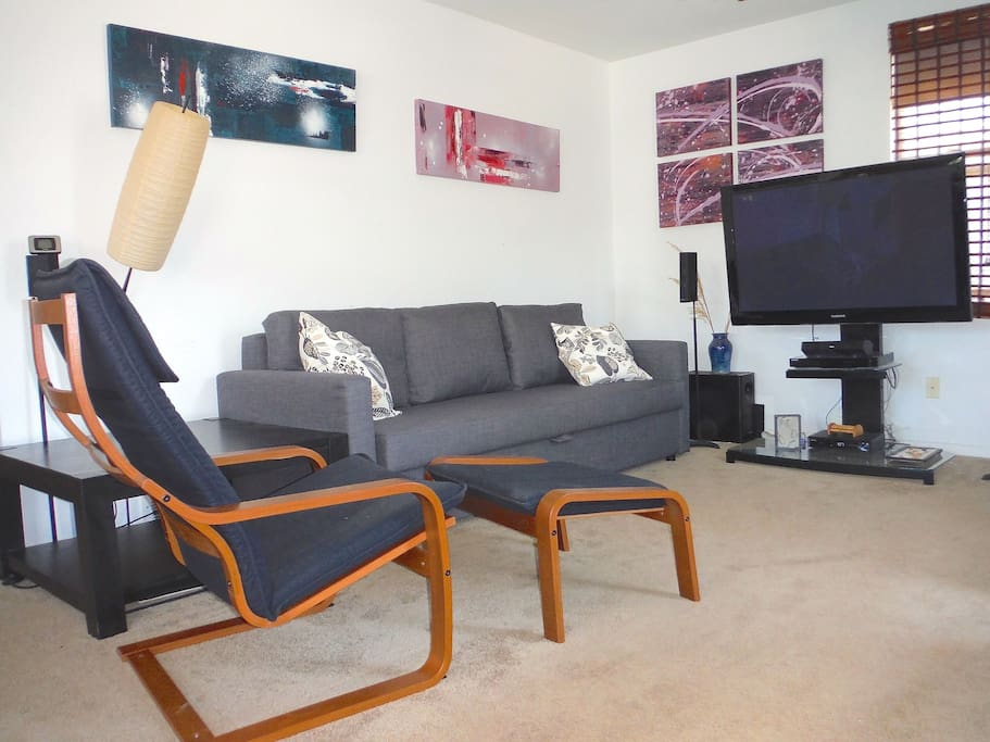 Comfy Ikea chairs with deluxe queen sofa bed .