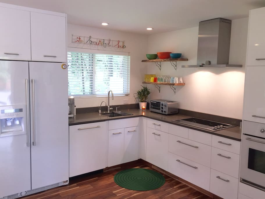 Full chefs kitchen; Ceasarstone Quartz counters, electric cooktop, Instahot for your tea or French press coffee, filtered water - everything is new, modern and clean!