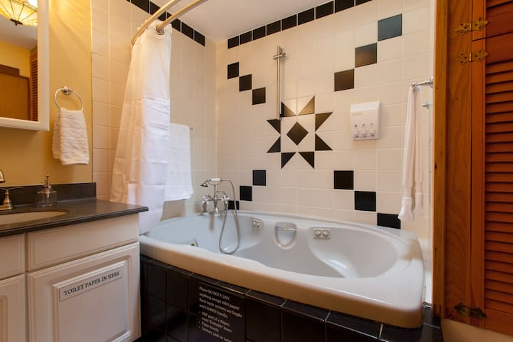 Bathroom with jetted Jacuzzi tub
