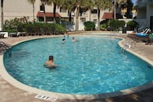 Adult pool is temperature controlled year round; also a hot whirlpool spa next to it.  Pool towels provided by the pool.