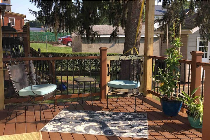Back porch - deck, all new. Beautiful and comfortable outdoor space to enjoy the sunrise... or have a glass of wine in the evening...