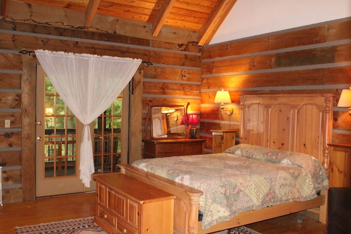 Master bedroom with private bath and screened in porch