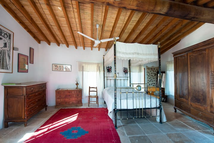 Master bedroom, first floor with traditional 100 year old bed