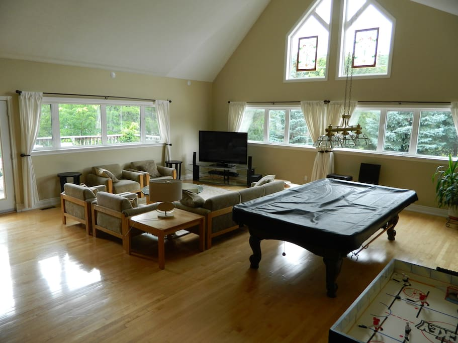 Great room with pool table, table hockey, 60 inch tv with cable and surround sound