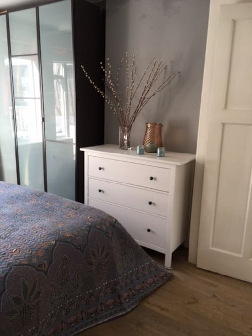Master bedroom with chest of drawers.