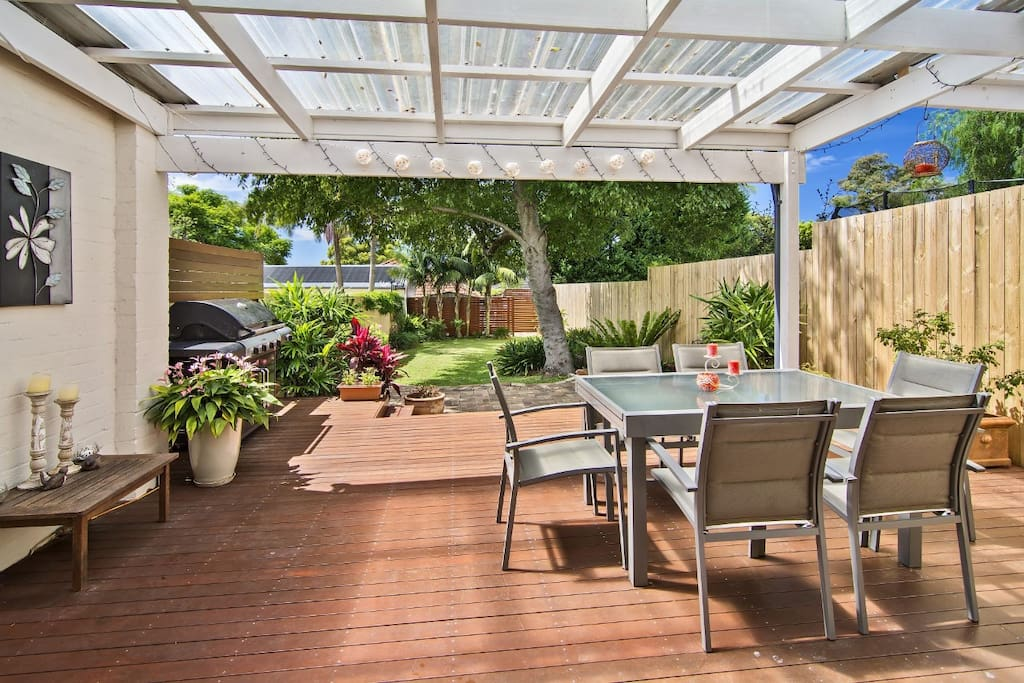 Entertaining deck overlooking lush, private and quiet garden.