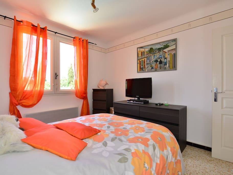 The bright and sunny double bedroom with its own flat screen TV