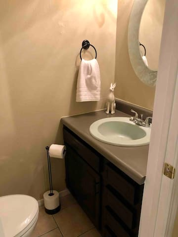 Half bath conveniently located downstairs.