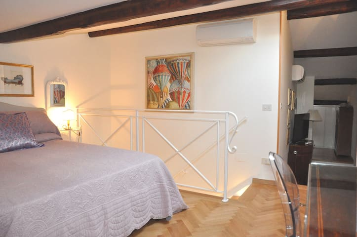 Bedroom - double bed, staircase railing, air conditioning split