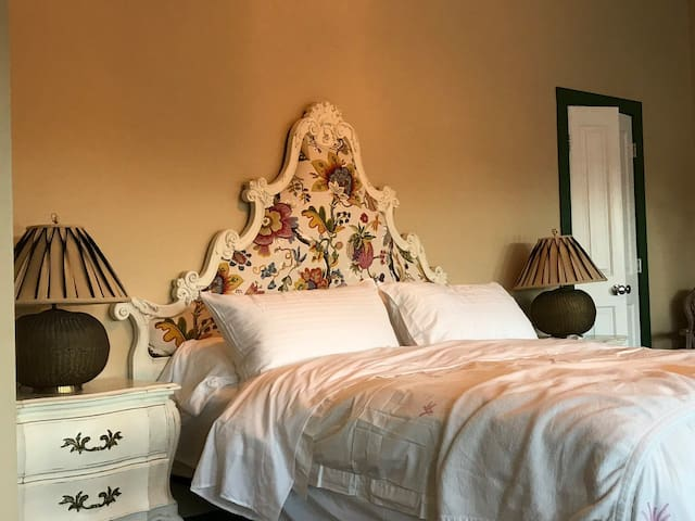 California King bed for you tall folks. Solid wood bombay style furniture and hand carved headboard.  Huge closet behind the door.