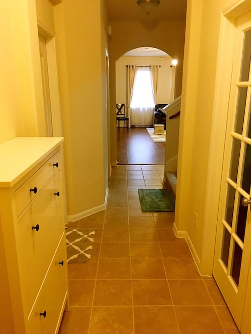 View of the clean, tiled hallway in this brand new, just purchased house. Fully renovated and furnished in a classic style! You will feel right at home!