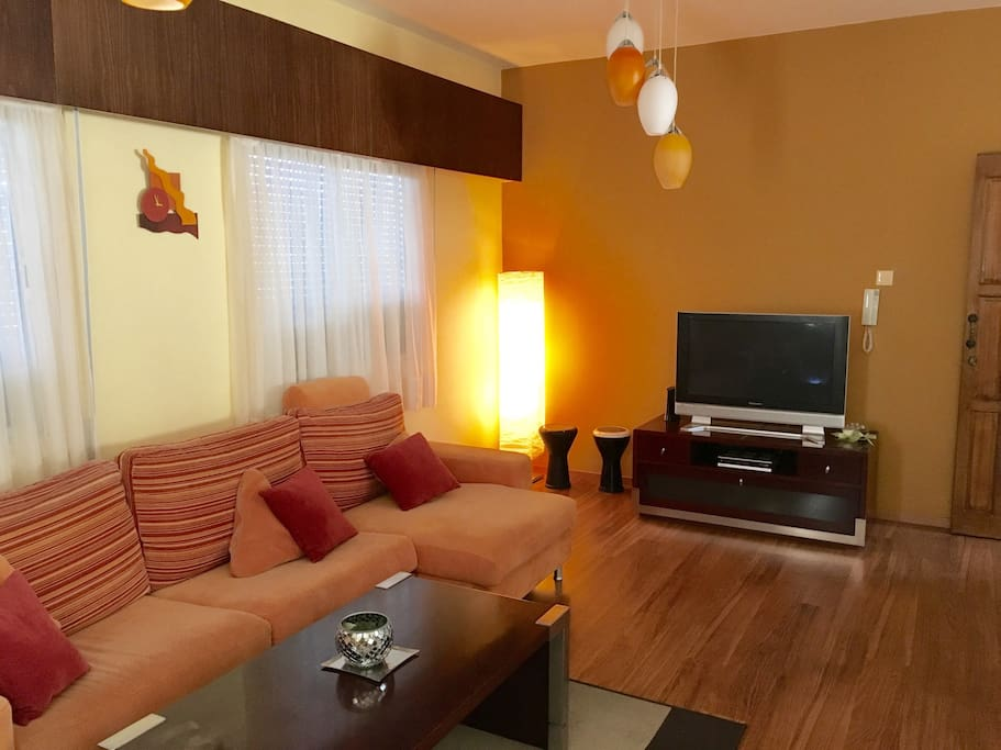 A spacious colorful living room and a plasma TV with Satellite and local channels!!