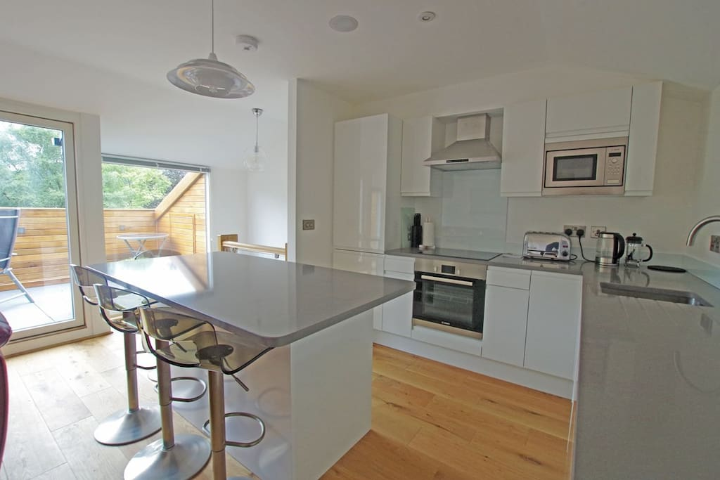 Kitchen area. Bosch appliances and seating for 6. Fridge freezer, microwave hob, cooker and dishwasher.