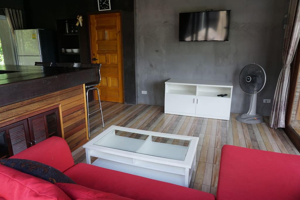 Resting area. Smart TV, fan, comfort sofa And you can see the door - access to master bedroom