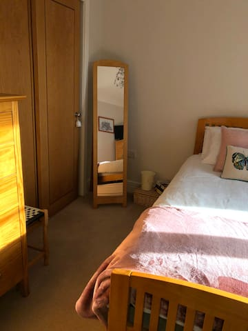 Their is two chest of drawers and one bedside cabinet.