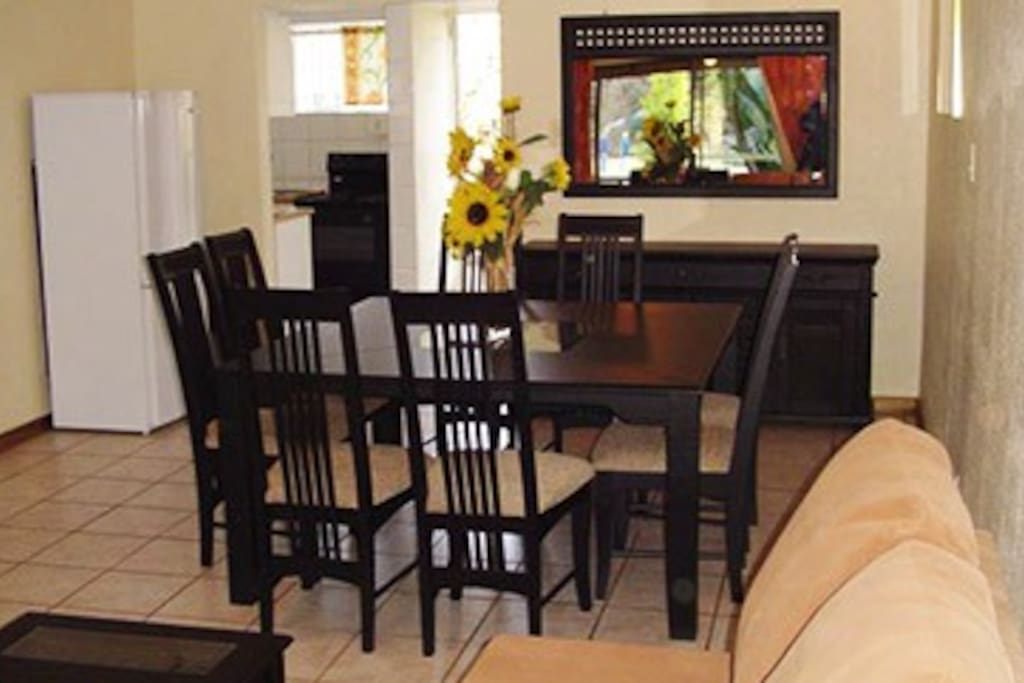 Living/Dining area with kitchenette in background