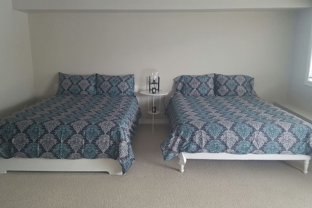 Two queen beds, spacious room.