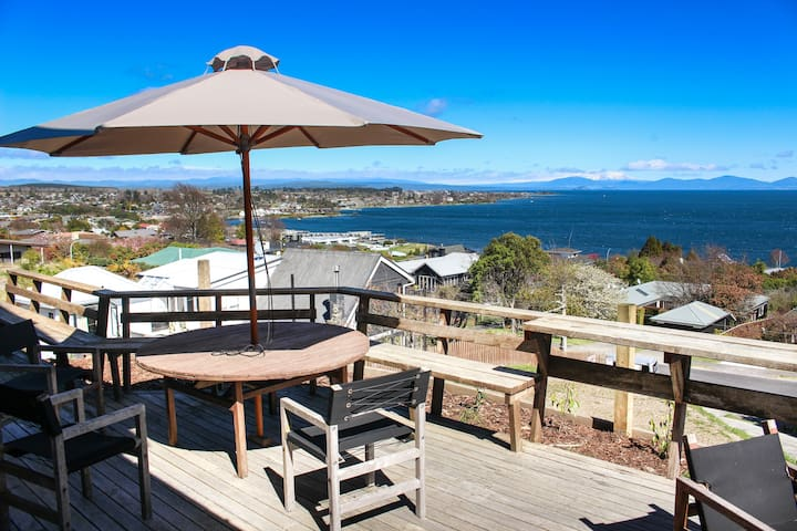 Panoramic lake and mountain views from the front deck