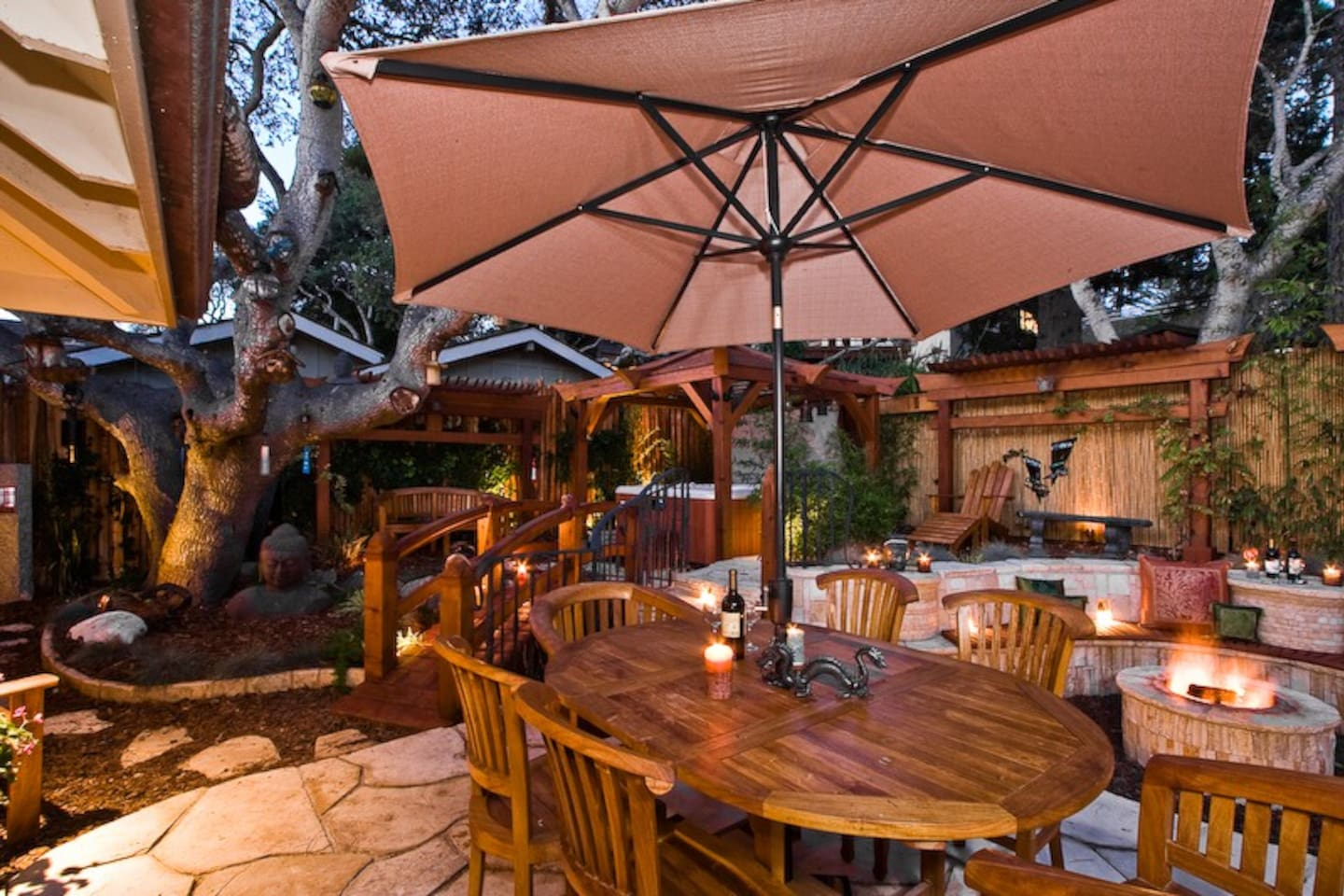 DragonsFyre's back garden with table seating for six under a shade umbrella.