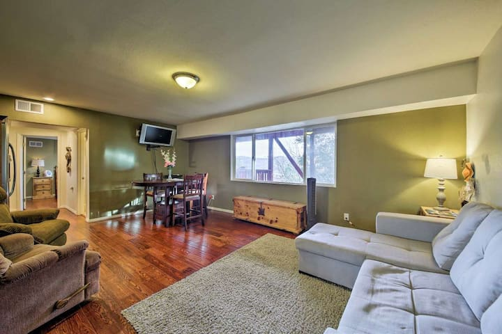 Step into this woodsy but contemporary open concept apartment. With a plush couch featuring seating for 6 (not pictured) and a pull out memory foam FULL sized bed everyone will be comfortable, relaxed, and spread out.