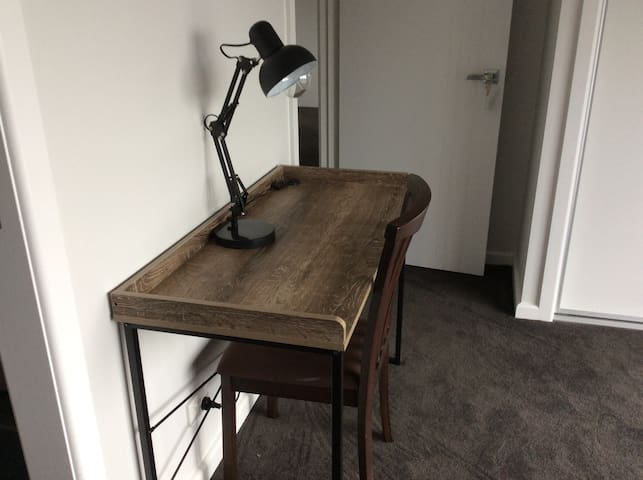 Desk with USB ports and desk lamp.