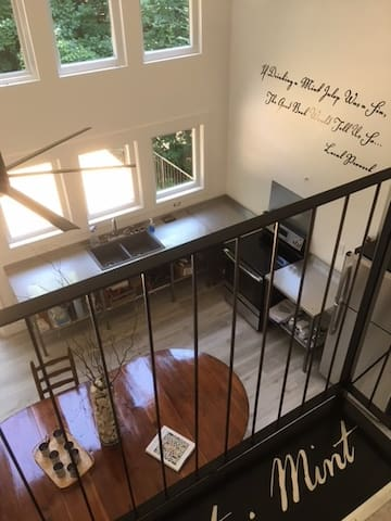 The Master Bedroom has a tiny balcony that opens onto the kitchen.