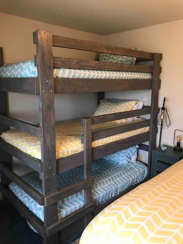Triple bunk bed in the third bedroom.