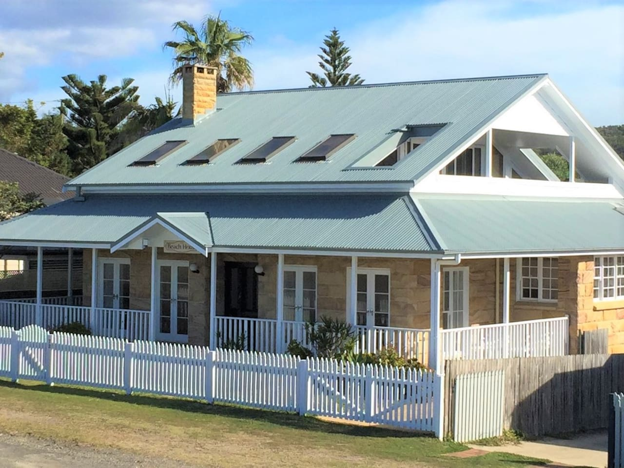 The Beach House with verandah overlooking the beach - 50m to the flags!