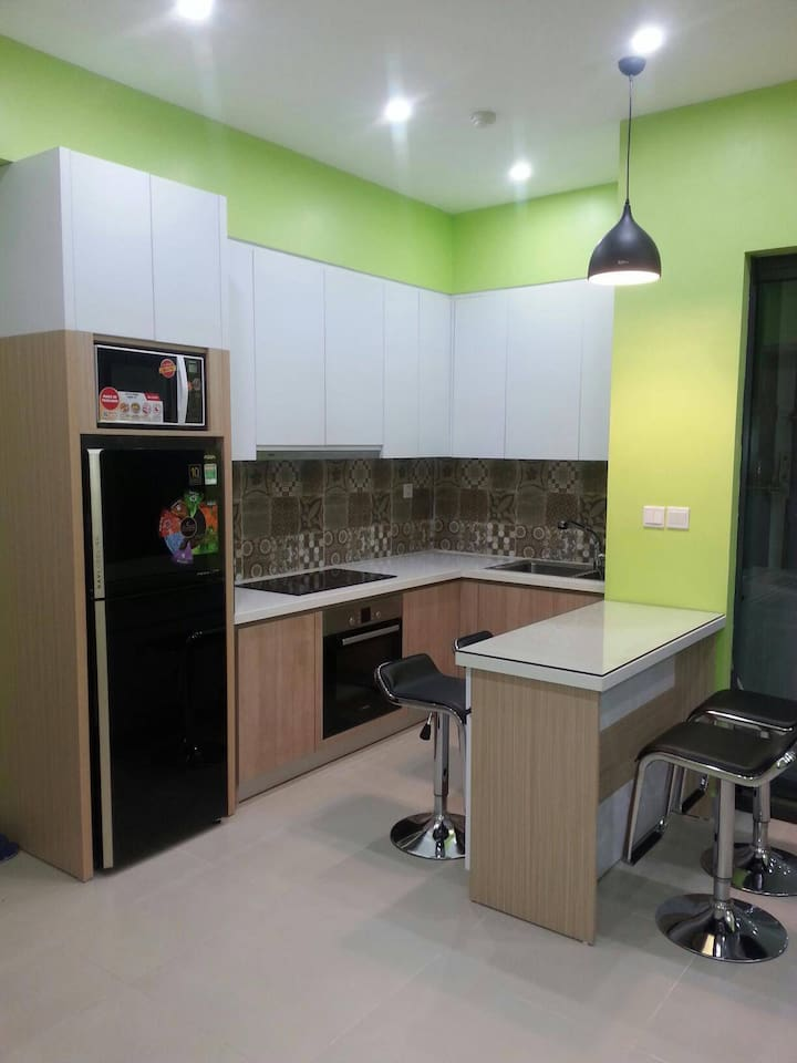 Kitchen with oven, refrigerator, microwave, induction stove