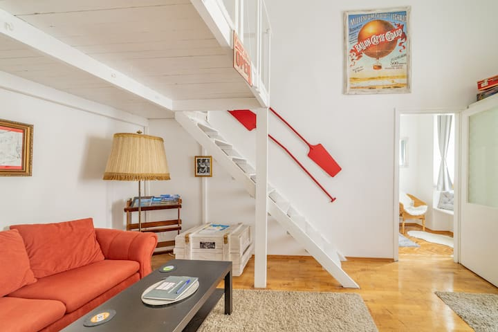 Living room with staircase to the gallery