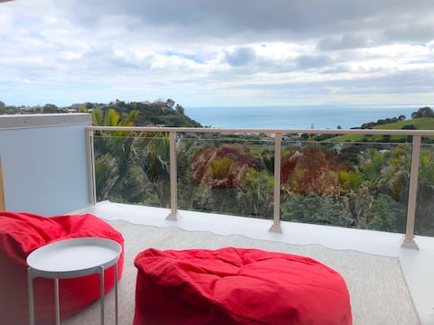 Private bedroom and bath with view to Hauraki Gulf