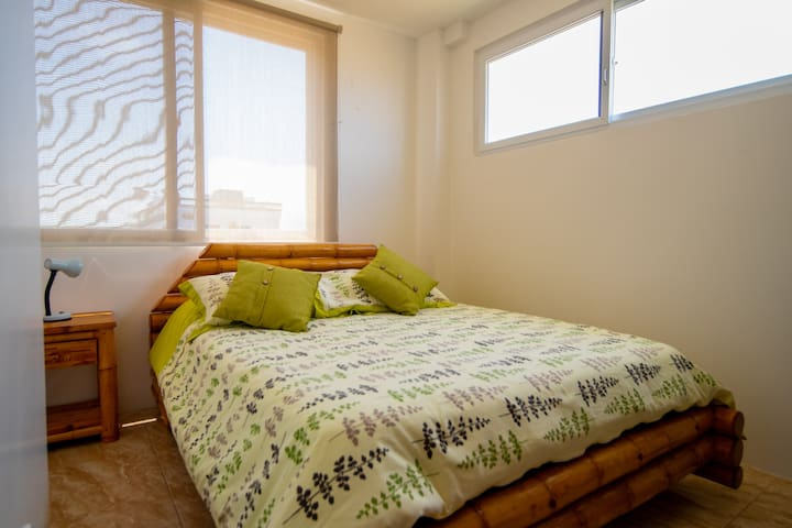 Bedroom #3 with queen size bed / locally made furniture.