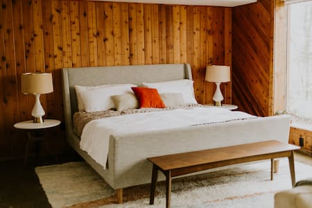 """Quiet and """"knotty"""" guest room"""