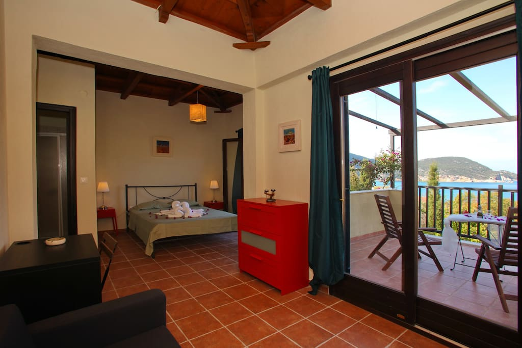studio/bedroom,3rd floor with exit to veranda with fantastic views.Has a couch,desk and a closet and chest of drawers